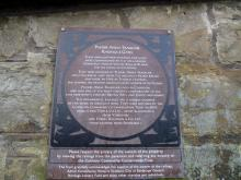 Plaque to Phoebe Anna Traquair at Railings and Gates at 25 Bridge Road, Colinton