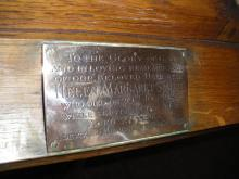 Brass plate attached to pulpit.